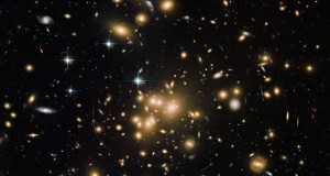 Gigantic Galaxy Cluster Blazes in Amazing New Hubble Photo